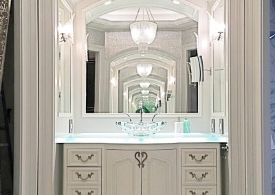 Bow front vanities with LED lit glass countertop