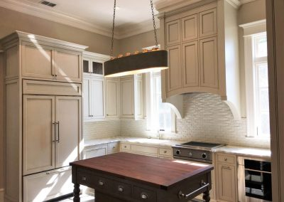 Painted and glazed prep kitchen cabinetry and island with black walnut top - Columbia, SC