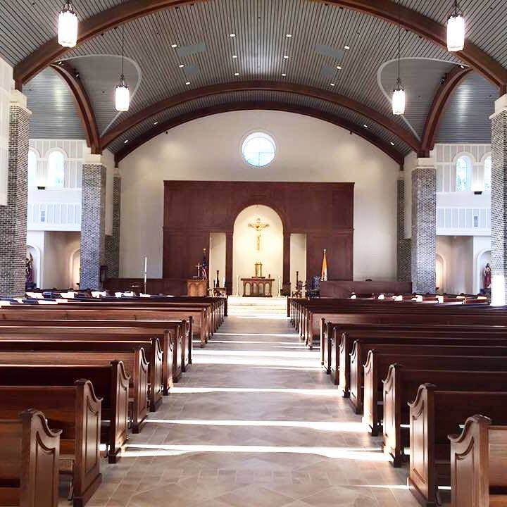 Curved beams, reredos, and window, wall, and door trim in St. Anne Catholic Church - Richmond Hill, GA