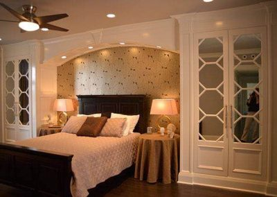 Built-in closets with octagon mullion doors and arch over the bed - Chicago, IL