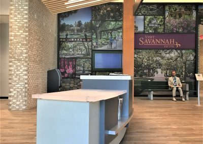 Chatham County Welcome Center, Savannah, GA - Reception desk with Forrest Gump on the park bench.
