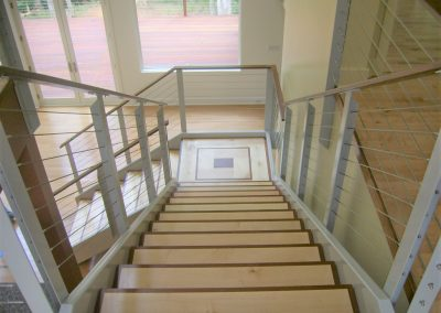 Ipe and maple stair treads with Ipe handrail